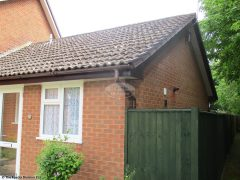 Rosewood fascia, white soffit with brown half round guttering in Romsey