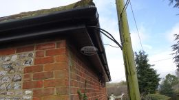 Black ash fascia, soffit and Black round upvc guttering in Alresford