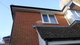 Black round gutters, White soffit and fascia