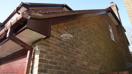 Image of box end detail in Rosewood fascias White soffit, Brown square guttering
