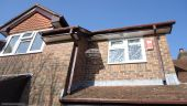 Rosewood bargeboards and fascia, Brown square guttering, White soffits in Winchester, Hampshire