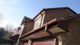 Rosewood fascias, white soffit and Brown square guttering, Winchester