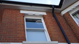 White hollow soffit, with White Ogee fascia board and Black gutters Shirley
