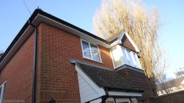 White soffits with black guttering