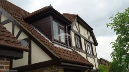Rosewood replacement fascia board tongue and groove soffit with half round brown guttering