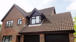 Southampton Recent Installation Garage Rooftrim Rosewood Fascias Soffits And Guttering Brown Downpipe