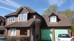 Upvc replacement rosewood fascia soffit and guttering black downpipe rooftrim locksheath