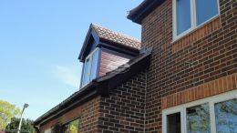 replacement fascia soffit in rosewood with black guttering locksheath cladding installation rear