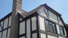 Installation of new rosewood UPVC fascias soffits and brown guttering on a detached house in Hedge End Southampton