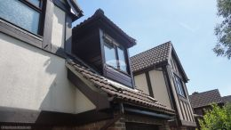 Replacing fascias soffits and guttering and shiplap cladding on a window dormer on a detached house Hedge End Southampton