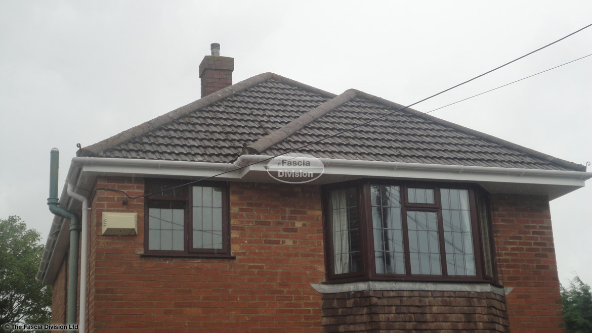 White UPVC fascia board, white UPVC tongue and groove soffit with white halfround guttering