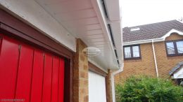 Recent installation of white UPVC fascia board tongue and groove soffits square line guttering over garage Rownhams Southampton