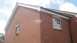 Installation of white UPVC standard fascia board soffit with black half round guttering West End Southampton