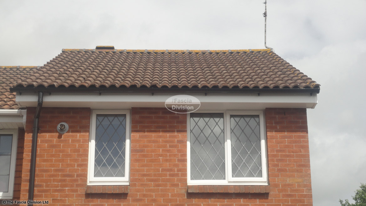 New UPVC white standard fascia board and soffit with black halfround guttering West End Southampton