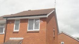 Replacement UPVC white standard fascia board and soffit with black halfround guttering West End Southampton