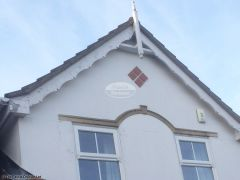 Before installation showing wooden decorative fascia with wooden roof spire Hedge End