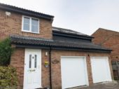 Black fascia and soffit installation to a detached house in Botley