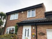 Black UPVC fascias and soffits with black UPVC guttering Botley