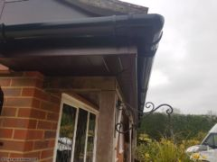 Rosewood fascia and soffit with black guttering Alresford