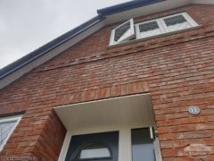 White soffit with anthracite grey fascias and guttering