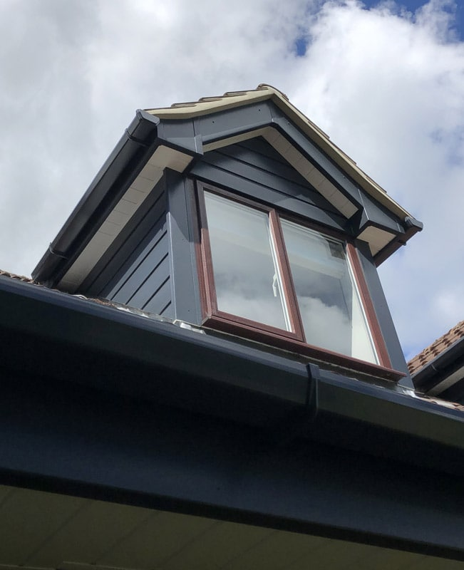 Shiplap cladding and fascia on a dormer window
