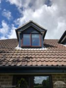 Fascia and cladding on a dormer window