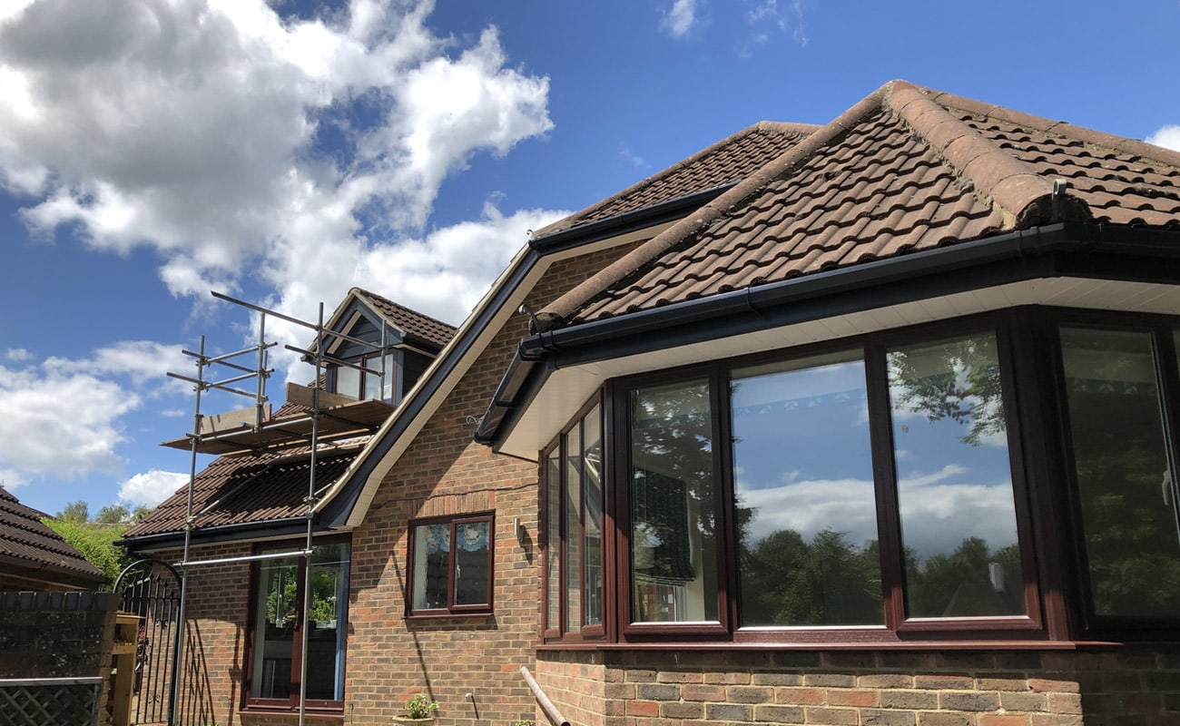 New Fascia, soffit, guttering and cladding on a house