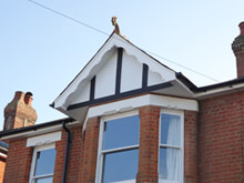 Replica Wood mock tudor beams with white render board